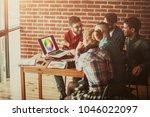team of designers in the... | Shutterstock . vector #1046022097