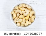 cashew nuts cashews from above... | Shutterstock . vector #1046038777