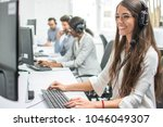 young smiling operator woman...   Shutterstock . vector #1046049307