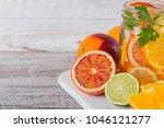 citrus fruit and herbs water... | Shutterstock . vector #1046121277
