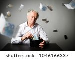 worried old man in white is... | Shutterstock . vector #1046166337