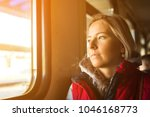 woman traveling by train | Shutterstock . vector #1046168773