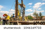 geothermal drillers at work.... | Shutterstock . vector #1046169733