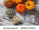colorful pumpkins and seeds... | Shutterstock . vector #1046170447