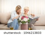 mother and daughter watch a... | Shutterstock . vector #1046213833