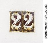 enameled house number twenty-two, on two separate plates - stock photo