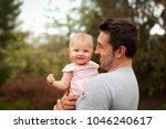 a father laughs and interacts...   Shutterstock . vector #1046240617