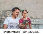 an unidentified person helps an ...   Shutterstock . vector #1046329333