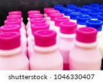 close up shot of bottles with... | Shutterstock . vector #1046330407