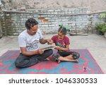 unidentified person in ludhiana ...   Shutterstock . vector #1046330533