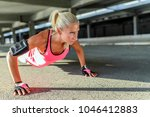 athletic woman doing push ups... | Shutterstock . vector #1046412883