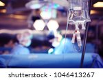 medical dropper hanging on a... | Shutterstock . vector #1046413267