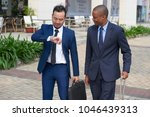 business people checking time... | Shutterstock . vector #1046439313