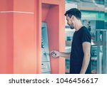 young man using credit card for ...   Shutterstock . vector #1046456617