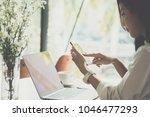 businesswoman holding mobile... | Shutterstock . vector #1046477293