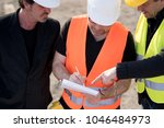 civil engineers wearing... | Shutterstock . vector #1046484973