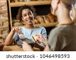happy cashier with pos terminal ... | Shutterstock . vector #1046498593
