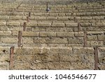 Small photo of Architectural detail in Pompei, Italy. Staircase of Pompei roman theatre in the ancient town, pigeon in background.