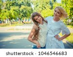 friends. mother and daughter...   Shutterstock . vector #1046546683