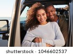 young mixed race couple... | Shutterstock . vector #1046602537
