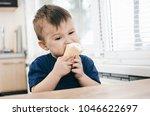 a child in a dark blue t shirt... | Shutterstock . vector #1046622697