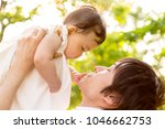 young father lift and playing...   Shutterstock . vector #1046662753