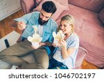 modern young couple eating... | Shutterstock . vector #1046702197