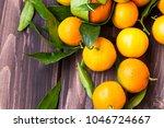 clementines citrus fruits heap... | Shutterstock . vector #1046724667