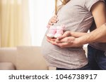 man and his pregnant wife are...   Shutterstock . vector #1046738917