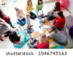 young moms with their kids   Shutterstock . vector #1046745163