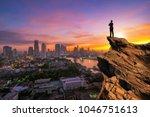 businessmen stand on high peaks ... | Shutterstock . vector #1046751613