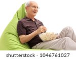 senior seated on a green... | Shutterstock . vector #1046761027
