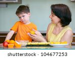 Cute little boy refuses to taste muffin - stock photo