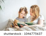 happy family mother reading to...   Shutterstock . vector #1046775637