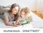 happy family mother reading to...   Shutterstock . vector #1046776057