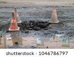 asphalt road with damage | Shutterstock . vector #1046786797