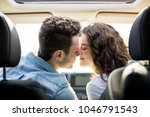 rear view of a romantic young... | Shutterstock . vector #1046791543