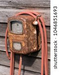 Small photo of Old Rusty Vintage Antique Tire Air Pump and Hose
