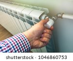 Small photo of hand adjust the volume of heating