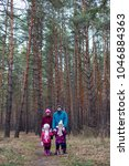 rural family in autumn forest.   Shutterstock . vector #1046884363