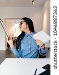 happy young brunette woman in...   Shutterstock . vector #1046887363