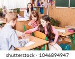 school girl explaining her... | Shutterstock . vector #1046894947