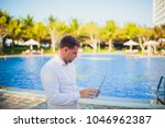 working on laptop from the...   Shutterstock . vector #1046962387
