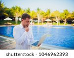 working on laptop from the...   Shutterstock . vector #1046962393