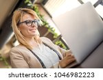 business woman is working on...   Shutterstock . vector #1046982223
