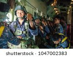 Small photo of Lopburi Thailand 7 MAr 2018: The air cadet paratrooper was checking statics line in C-130 Hecules with parachute before drop in the field in Airborne training.