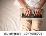 background of hand is typing on ...   Shutterstock . vector #1047058003