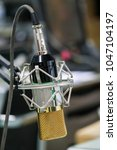 condensor microphone in the... | Shutterstock . vector #1047104197