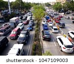Small photo of QUEZON CITY, PHILIPPINES - MARCH 9, 2018: Vehicles pass along a usually traffic congested Katipunan Avenue in Quezon City, Philippines.
