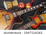 two jazz guitars and music... | Shutterstock . vector #1047116263